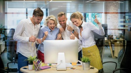 Happy business team celebrate success at work